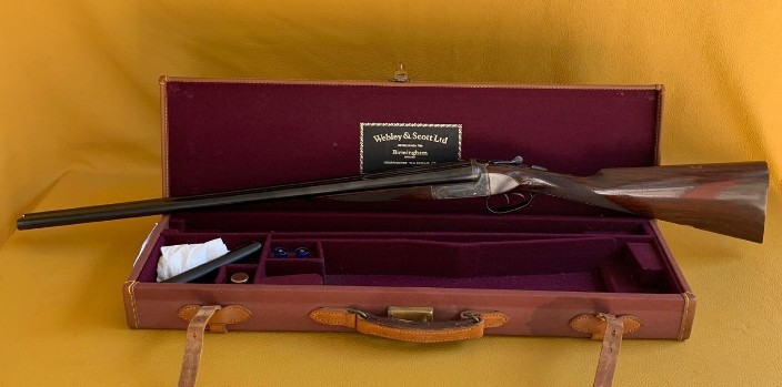 "Webley & Scott  Mod 720 .  20 Ga 2 ¾"" cased. First of a composed consecutive number pair."